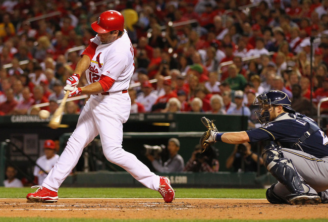 ST. LOUIS, MO -SEPTEMBER 6: Lance Berkman #12 of the St. Louis Cardinals hits an RBI single against the Milwaukee Brewers at Busch Stadium on September 6, 2011 in St. Louis, Missouri.  (Photo by Dilip Vishwanat/Getty Images)