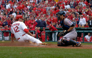 ST. LOUIS, MO - SEPTEMBER 22: Lance Berkman #12 of the St. Louis Cardinals slides safely past Josh Thole #30 of the New York Mets at Busch Stadium on September 22, 2011 in St. Louis, Missouri.  (Photo by Jeff Curry/Getty Images)