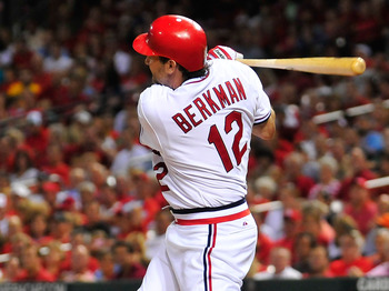 ST. LOUIS, MO - AUGUST 26: Lance Berkman #12 of the St. Louis Cardinals hits a two-run home run against the Pittsburgh Pirates at Busch Stadium on August 26, 2011 in St. Louis, Missouri.  (Photo by Jeff Curry/Getty Images)