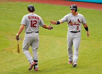 MIAMI GARDENS, FL - AUGUST 07: Ryan Theriot #3 of the St. Louis Cardinals is congratulated by Lance Berkman #12 after scoring during a game against the Florida Marlins at Sun Life Stadium on August 7, 2011 in Miami Gardens, Florida. (Photo by Mike Ehrmann