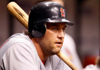 ST. PETERSBURG, FL - JULY 01:  Outfielder Lance Berkman #12 of the St. Louis Cardinals waits to bat against the Tampa Bay Rays during the game at Tropicana Field on July 1, 2011 in St. Petersburg, Florida.  (Photo by J. Meric/Getty Images)