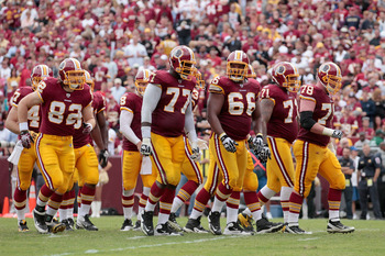 LANDOVER, MD - SEPTEMBER 18: The Washington Redskins offense walks to the line of scrimmage against the Arizona Cardinals at FedExField on September 18, 2011 in Landover, Maryland.  (Photo by Rob Carr/Getty Images)