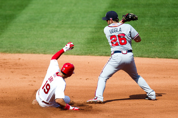 ST. LOUIS, MO - SEPTEMBER 11: Jon Jay #19 of the St. Louis Cardinals slides safely into second base as Dan Uggla #26 of the Atlanta Braves tries to apply the tag during the game at Busch Stadium on September 11, 2011 in St. Louis, Missouri. The St. Louis