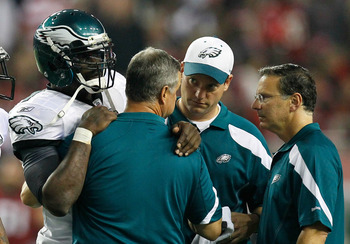 ATLANTA, GA - SEPTEMBER 18:  Michael Vick #7 of the Philadelphia Eagles is helped off the field after being injured in the third quarter against the Atlanta Falcons at Georgia Dome on September 18, 2011 in Atlanta, Georgia.  (Photo by Kevin C. Cox/Getty I
