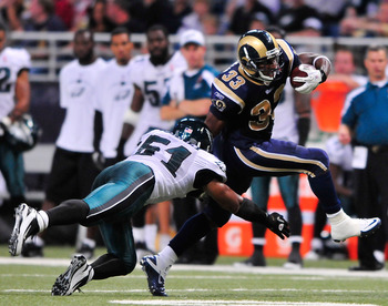 ST. LOUIS, MO - SEPTEMBER 11: Cadillac Williams #33 of the St. Louis Rams runs as Jamar Chaney #51 of the Philadelphia Eagles dives for a tackle at the Edward Jones Dome on September 11, 2011 in St. Louis, Missouri. The Eagles defeated the Rams 31-15. (Ph
