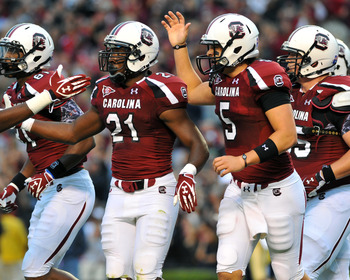 COLUMBIA, SC - SEPTEMBER 17:  Running back Marcus Lattimore #21 of the South Carolina Gamecocks celebrates a touchdown with quarterback Stephen Garcia #5 against the Navy Midshipmen September 17, 2011 at Williams-Brice Stadium in Columbia, South Carolina.