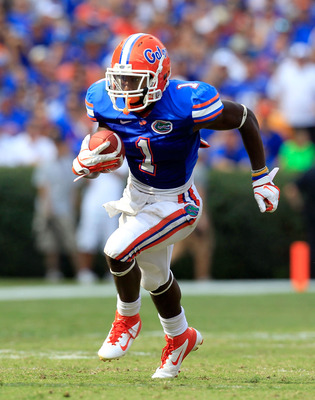 GAINESVILLE, FL - SEPTEMBER 17:  Running back Chris Rainey #1 of the Florida Gators runs for yardage during a game against the Tennessee Volunteers at Ben Hill Griffin Stadium on September 17, 2011 in Gainesville, Florida.  (Photo by Sam Greenwood/Getty I