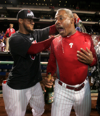 PHILADELPHIA, PA - SEPTEMBER 17: Antonio Bastardo (L) of the Philadelphia Phillies soaks third base coach Juan Samuel with beer after defeating the St. Louis Cardinals 9-2 and clinch the National League East division championship on September 17, 2011 at