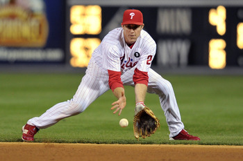 PHILADELPHIA, PA - SEPTEMBER 19: Chase Utley #26 of the Philadelphia Phillies fields a ground ball during the game against the St. Louis Cardinals at Citizens Bank Park on September 19, 2011 in Philadelphia, Pennsylvania. The Cardinals won 4-3. (Photo by