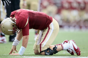 CHESTNUT HILL, MA - SEPTEMBER 03:  Chase Rettig #11 of the Boston College Eagles is slow to get up after he is sacked in the fourth quarter against the Northwestern Wildcats on September 3, 2011 at Alumni Stadium in Chestnut Hill, Massachusetts.The Northw
