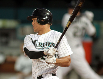 MIAMI GARDENS, FL - SEPTEMBER 21:  Mike Stanton #27 of the Florida Marlins drives a base hit against the Atlanta Brave at Sun Life Stadium on September 21, 2011 in Miami Gardens, Florida.  (Photo by Marc Serota/Getty Images)