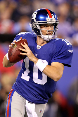 EAST RUTHERFORD, NJ - SEPTEMBER 19:  Quarterback Eli Manning #10 of the New York Giants looks to pass against the St. Louis Rams at MetLife Stadium on September 19, 2011 in East Rutherford, New Jersey. The Giants won 28-16.  (Photo by Al Bello/Getty Image