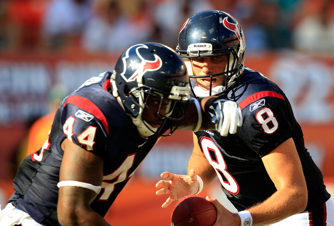 MIAMI GARDENS, FL - SEPTEMBER 18:  Houston Texans quarterback Matt Schaub #8 attempts a handoff to running back Ben Tate #44 during a game against the Miami Dolphins at Sun Life Stadium on September 18, 2011 in Miami Gardens, Florida.  (Photo by Sam Green