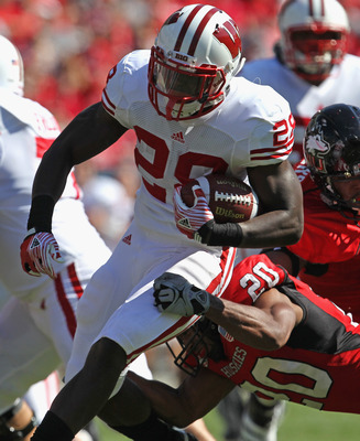 CHICAGO, IL - SEPTEMBER 17: Montee Ball #28 of the Wisconsin Badgers breaks away from Tommy Davis #20 of the Northern Illinois Huskies at Soldier Field on September 17, 2011 in Chicago, Illinois. (Photo by Jonathan Daniel/Getty Images)