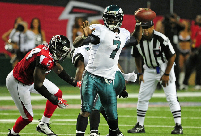 ATLANTA - SEPTEMBER 18: Michael Vick #7 of the Philadelphia Eagles passes against the Atlanta Falcons at the Georgia Dome on September 18, 2011 in Atlanta, Georgia. (Photo by Scott Cunningham/Getty Images)