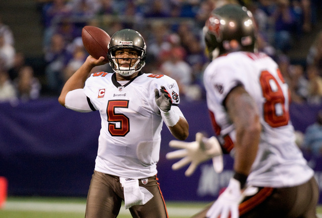 MINNEAPOLIS, MN - SEPTEMBER 18: Josh Freeman #5 of the Tampa Bay Buccaneers looks to pass to Kellen Winslow #82 of the Tampa Bay Buccaneers in the third quarter against the Minnesota Vikings on September 18, 2011 at Hubert H. Humphrey Metrodome in Minneap