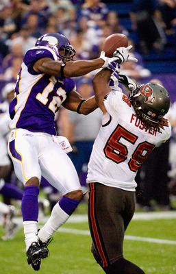 MINNEAPOLIS, MN - SEPTEMBER 18: Mason Foster #59 of the Tampa Bay Buccaneers is called on pass interference against Percy Harvin #12 of the Minnesota Vikingson September 18, 2011 at Hubert H. Humphrey Metrodome in Minneapolis, Minnesota. The Buccaneers de