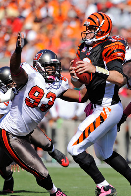 CINCINNATI, OH - OCTOBER 10:  Gerald McCoy #93 of the Tampa Bay Buccaneers puts pressure on quarterback Carson Palmer #9 of the Cincinnati Bengals at Paul Brown Stadium on October 10, 2010 in Cincinnati, Ohio.  (Photo by Jamie Sabau/Getty Images)