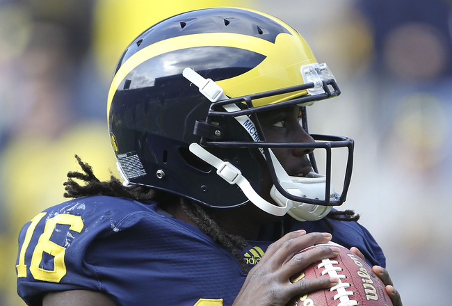 ANN ARBOR, MI - SEPTEMBER 24:  Denard Robinson #16 of the Michigan Wolverines warms up prior to the start of the game against San Diego State at Michigan Stadium on September 24, 2011 in Ann Arbor, Michigan.  (Photo by Leon Halip/Getty Images)