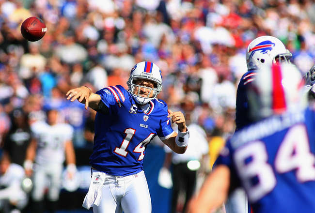 ORCHARD PARK, NY - SEPTEMBER 18:  Ryan Fitzpatrick #14 of the Buffalo Bills throws a pass to  Scott Chandler #84 against the Oakland Raiders at Ralph Wilson Stadium on September18, 2011 in Orchard Park, New York. Buffalo won 38-35.  (Photo by Rick Stewart