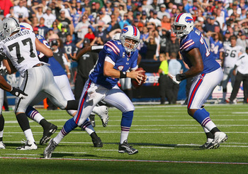 ORCHARD PARK, NY - SEPTEMBER 18:  Ryan Fitzpatrick #14 of the Buffalo Bills runs late in the fourth quarter against the Oakland Raiders at Ralph Wilson Stadium on September 18, 2011 in Orchard Park, New York. Buffalo won 38-35.  (Photo by Rick Stewart/Get