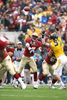 JACKSONVILLE, FL - JANUARY 01:  Quarterback E.J. Manuel #3 of the Florida State Seminoles throws a pass against the West Virginia Mountaineers during the Konica Minolta Gator Bowl on January 1, 2010 at Jacksonville Municipal Stadium in Jacksonville, Flori