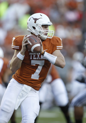 AUSTIN, TX - SEPTEMBER 10:  Quarterback Garrett Gilbert #7 of the Texas Longhorns rolls out for a first quarter pass against the BYU Cougars on September 10, 2011 at Darrell K. Royal-Texas Memorial Stadium in Austin, Texas. Gilbert was replaced in the sec