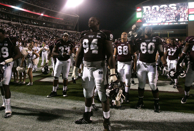STARKVILLE, MS - SEPTEMBER 15:  Mississippi State players gather in the end zone for the playing of the Alma Mater after the loss to LSU 19-6 on September 15, 2011 at Davis Wade stadium in Starkville, Mississippi. (Photo by Butch Dill/Getty Images)