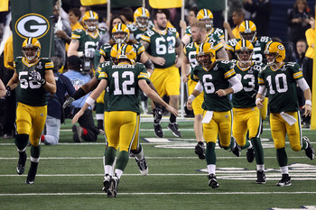 ARLINGTON, TX - FEBRUARY 06: Aaron Rodgers #12 of the Green Bay Packers leads his team onto the field prior to Super Bowl XLV at Cowboys Stadium on February 6, 2011 in Arlington, Texas.  (Photo by Streeter Lecka/Getty Images)