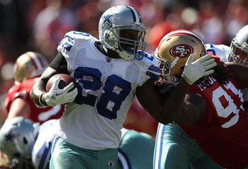 SAN FRANCISCO, CA - SEPTEMBER 18:  Felix Jones #28 of the Dallas Cowboys rushes against the San Francisco 49ers at Candlestick Park on September 18, 2011 in San Francisco, California.  (Photo by Jed Jacobsohn/Getty Images)
