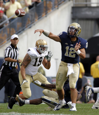 PITTSBURGH, PA - SEPTEMBER 24:  Tino Sunseri #12 of the Pittsburgh Panthers passes against the Notre Dame Fighting Irish during the game on September 24, 2011 at Heinz Field in Pittsburgh, Pennsylvania.  The Irish defeated the Panthers 15-12.  (Photo by J