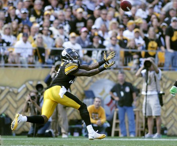 PITTSBURGH, PA - SEPTEMBER 18:   Mike Wallace #17 of the Pittsburgh Steelers catches a pass against the Seattle Seahawks during the game on September 18, 2011 at Heinz Field in Pittsburgh, Pennsylvania.  The Steelers defeated the Seahawks 24-0.  (Photo by