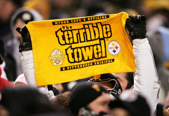 PITTSBURGH - JANUARY 23:  A fan holds up a 'terrible towel' as the New England Patriots take on the Pittsburgh Steelers in the AFC championship game at Heinz Field on January 23, 2005 in Pittsburgh, Pennsylvania. The Patriots defeated the Steelers 41-27.