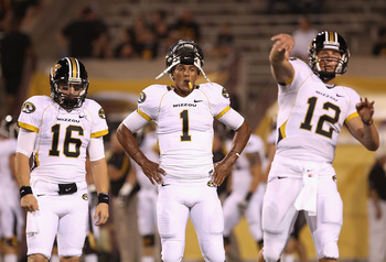 TEMPE, AZ - SEPTEMBER 09:  Quarterback James Franklin #1 (C) of the Missouri Tigers warms up before the college football game against the Arizona State Sun Devils at Sun Devil Stadium on September 9, 2011 in Tempe, Arizona. The Sun Devils defeated the Tig