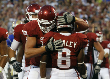 NORMAN, OK - SEPTEMBER 3:  Offensive tackle Lane Johnson #69 of the Oklahoma Sooners congratulates running back Dominique Whaley #8 after a touchdown during the first half against the Tulsa Hurricanes September 3, 2011 at Gaylord Family-Oklahoma Memorial