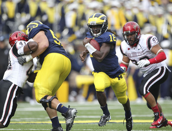 ANN ARBOR, MI - SEPTEMBER 24:  Denard Robinson #16 of the Michigan Wolverines runs for a first down during the first half of the game against San Diego State at Michigan Stadium on September 24, 2011 in Ann Arbor, Michigan.  (Photo by Leon Halip/Getty Ima