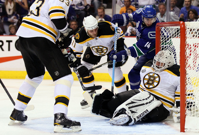 VANCOUVER, BC - JUNE 15:  Tim Thomas #30 of the Boston Bruins tends goal against Alex Burrows #14 of the Vancouver Canucks during Game Seven of the 2011 NHL Stanley Cup Final at Rogers Arena on June 15, 2011 in Vancouver, British Columbia, Canada.  (Photo