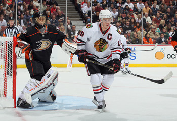 ANAHEIM, CA - NOVEMBER 26:  Jonathan Toews #19 of the Chicago Blackhawks screens goaltender Jonas Hiller #1 of the Anaheim Ducks at the Honda Center on November 26, 2010 in Anaheim, California.  (Photo by Jeff Gross/Getty Images)