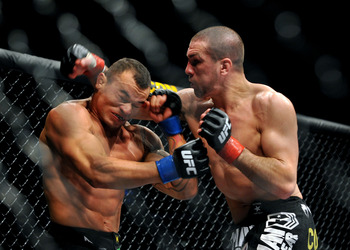 LOS ANGELES, CA - OCTOBER 24:  UFC fighter Josh Neer (R) battles with UFC fighter Gleison Tibau (L) during their Lightweight 'Swing' bout at UFC 104: Machida vs. Shogun at Staples Center on October 24, 2009 in Los Angeles, California.  (Photo by Jon Kopal