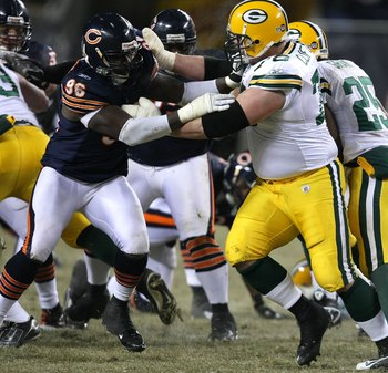 CHICAGO - DECEMBER 22: Alex Brown #96 of the Chicago Bears rushes against Chad Clifton #76 of the Green Bay Packers on December 22, 2008 at Soldier Field in Chicago, Illinois. The Bears defeated the Packers 20-17 in overtime. (Photo by Jonathan Daniel/Get