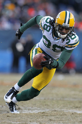 CHICAGO, IL - JANUARY 23:  Tramon Williams #38 of the Green Bay Packers returns a kick against the Chicago Bears in the NFC Championship Game at Soldier Field on January 23, 2011 in Chicago, Illinois.  (Photo by Jamie Squire/Getty Images)