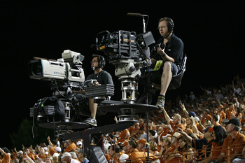AUSTIN, TX - SEPTEMBER 10:  A Video camera (L) is next to 3D camera during the NCAA football game between the Texas Longhorns and  the BYU Cougars on September 10, 2011 at Darrell K. Royal-Texas Memorial Stadium in Austin, Texas for ESPN and ESPN 3D.  Tex