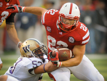 LINCOLN, NE - SEPTEMBER 17: Rex Burkhead #22 of the Nebraska Cornhuskers tries to slip past Garret Gilliland #53 of the Washington Huskies during their game at Memorial Stadium September 17, 2011 in Lincoln, Nebraska. Nebraska won 51-38.  (Photo by Eric F