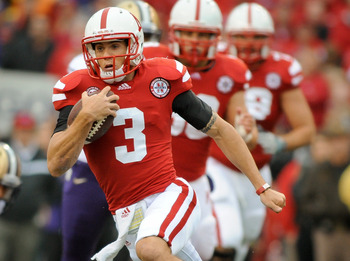 LINCOLN, NE - SEPTEMBER 17: Taylor Martinez #3 of the Nebraska Cornhuskers runs for the end zone past the Washington Huskies defense during their game at Memorial Stadium September 17, 2011 in Lincoln, Nebraska. Nebraska won 51-38.(Photo by Eric Francis/G