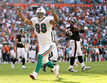 MIAMI GARDENS, FL - SEPTEMBER 18: Defensive end Jason Taylor #99 of the Miami Dolphins celebrates a sack against the Houston Texans at Sun Life Stadium on September 18, 2011 in Miami Gardens, Florida.  (Photo by Marc Serota/Getty Images)
