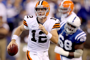 INDIANAPOLIS, IN - SEPTEMBER 18:  Quarterback Colt McCoy #12 of the Cleveland Browns is chased out of the pocket against the Indianapolis Colts at Lucas Oil Stadium on September 18, 2011 in Indianapolis, Indiana.  (Photo by Matthew Stockman/Getty Images)