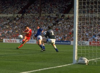 May 1989:  Ian Rush (centre) of Liverpool beats goalkeeper Neville Southall of Everton to score their second goal during the FA Cup final at Wembley Stadium in London. Liverpool won the match 3-2. \ Mandatory Credit: Simon  Bruty/Allsport
