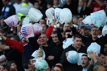 LIVERPOOL, UNITED KINGDOM - OCTOBER 20:  Liverpool fans make fun of the Everton fans by showing Tescos carrier bags during the Barclays Premier League match between Everton and Liverpool  at Goodison Park on October 20, 2007 in Liverpool, England.  (Photo