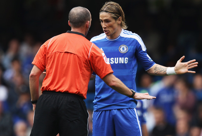 LONDON, ENGLAND - SEPTEMBER 24:  Fernando Torres of Chelsea talks to referee Mike Dean during the Barclays Premier League match between Chelsea and Swansea City at Stamford Bridge on September 24, 2011 in London, England.  (Photo by Clive Rose/Getty Image