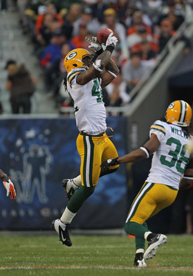 CHICAGO, IL - SEPTEMBER 25: Morgan Burnett #42 of the Green Bay Packers intercepts a pass in front of teammate Tramon Williams #38 against the Chicago Bears at Soldier Field on September 25, 2011 in Chicago, Illinois. The Packers defeated the Bears 27-17.
